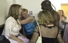 Crazy girls having fun with a male stripper